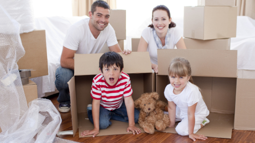 family moving house surrounded by boxes